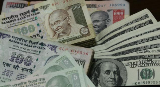 Rupee drops 26 paise against dollar in late morning trade