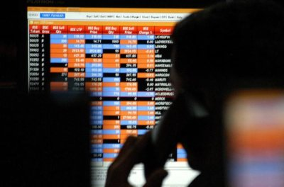Sensex trades flat in pre-noon trade