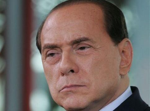 Berlusconi faces trial in bribery case