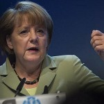 Merkel hails Greek progress in cutting debt