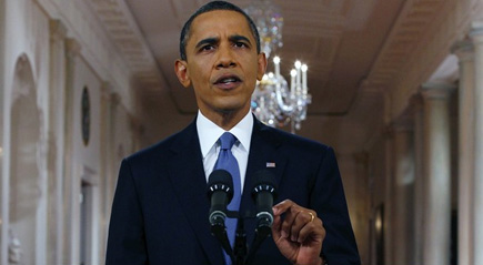 Obama says sorry to Americans dropped by insurers