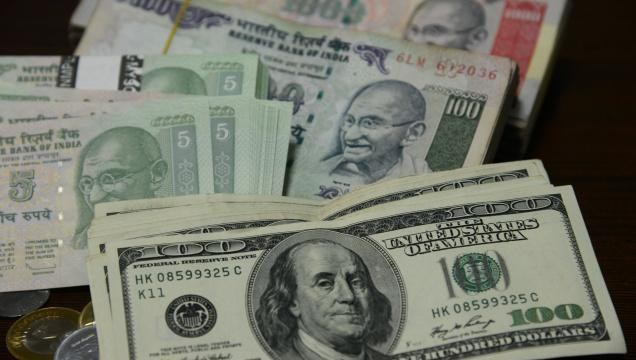 Rupee plunged by 77 paise to one-month low versus US dollar