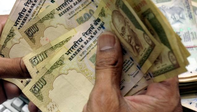 Indian rupee trims initial losses vs dollar, still down 5 paise