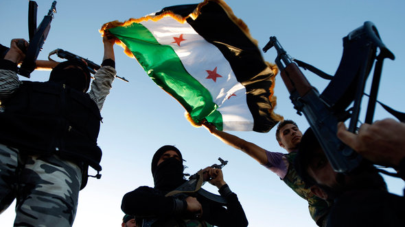 Six Syrian Islamist factions unite in bid to oust Assad