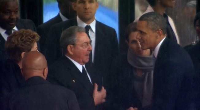 Obama-Castro handshake stirs speculation, controversy
