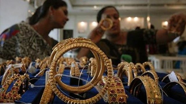 Gold steady after two-day fall, economic optimism weighs
