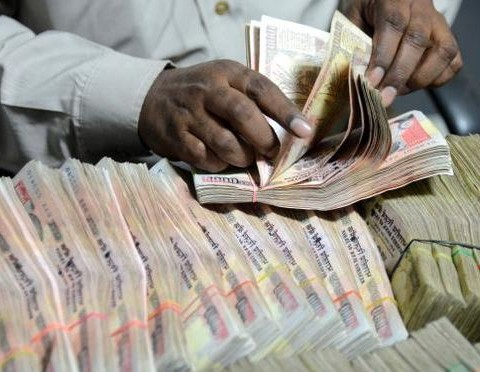 Rupee down 12 paise on dollar demand