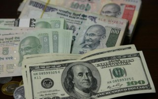Rupee rules at one-month high; up 30 paise vs Dollar