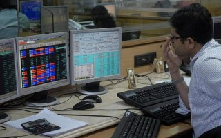 Sensex trades flat during pre-noon trade