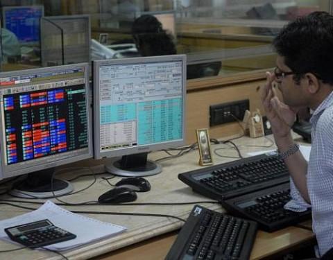 Sensex trades flat during pre-noon trade