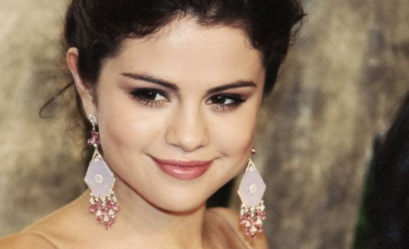 Selena Gomez `in high spirits` after canceling tour