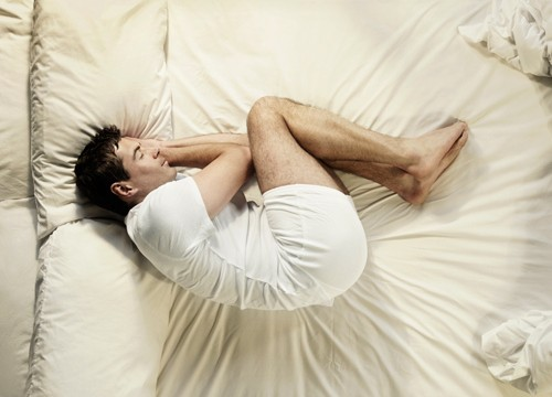 Why people in pain get relief in foetal position
