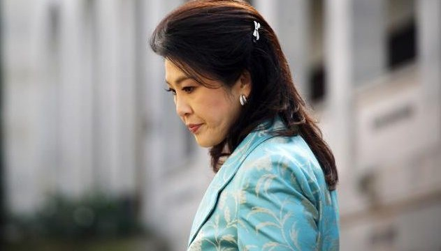 Thailand PM Yingluck Shinawatra vows to continue to perform duties