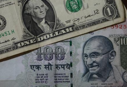 Rupee down 21 paise against dollar in early trade