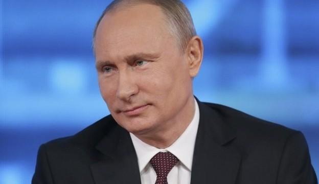 Russian President Vladimir Putin defends bailout for Ukraine