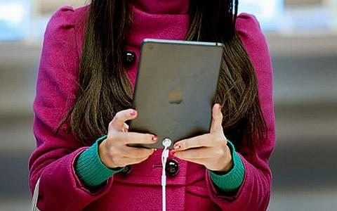 A woman uses the iPad Mini