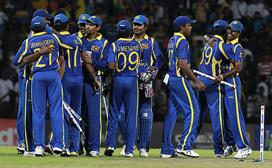 Sri Lanka teammembers celebrate after they winning the Twenty20 series cricket match against Australia in Kandy