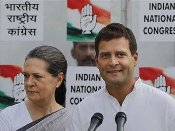 Sonia_Gandhi_360_Rahul_Gandhi_360_smiling_16May14_AP