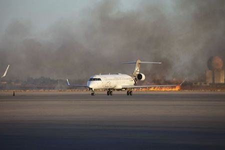 Smoke rises after a shelling at Tripoli International Airport July 15, 2014