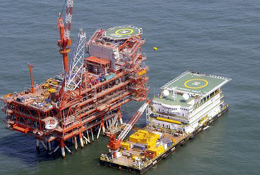 Undated handout photo of India's Reliance Industries KG-D6's control and raiser platform seen off the Bay of Bengal