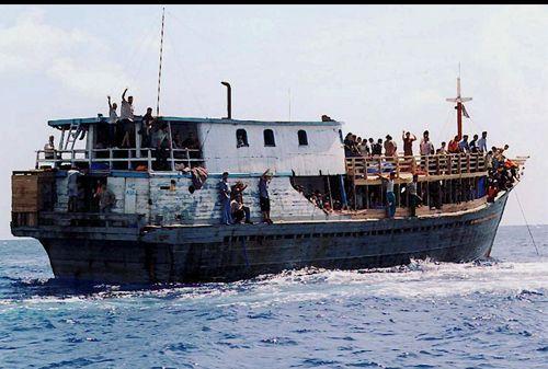 248528-immigrants-asylum-seekers-boat-afp