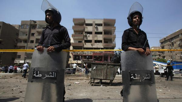Riot police guard the site of an explosion near the house of Egypt's interior minister at Cairo's Nasr City district