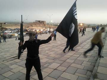 isis-man-flag-reuters-360