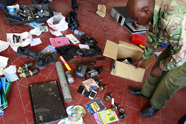 Hand grenades and other items are displayed by police after an early morning raid at a mosque in the coastal town of Mombasa
