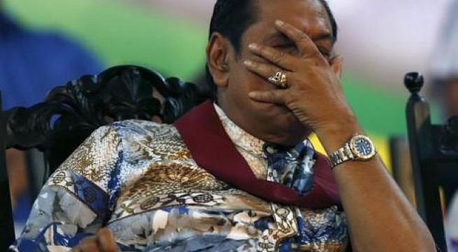 Sri Lanka's President Mahinda Rajapaksa reacts during his final rally ahead of presidential election in Piliyandala