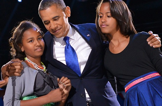US President Barack Obama hugs his daughters Sasha (L) and Malia (R) on election night November 6, 2012 in Chicago, Illinois. President Barack Obama swept to re-election Tuesday, forging history again by transcending a slow economic recovery and the high unemployment which haunted his first term to beat Republican Mitt Romney. AFP PHOTO/Jewel Samad        (Photo credit should read JEWEL SAMAD/AFP/Getty Images)