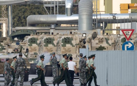 Chinese self propelled howitzers prepare to take part in rehearsals ahead of the Sept. 3 military parade to commemorate the end of World War II in Beijing, Saturday, Aug. 22, 2015. China is ramping up publicity for its upcoming massive military parade but officials still aren't saying what other countries are taking part. (AP Photo/Ng Han Guan)