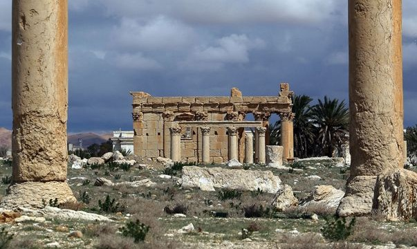 """FILES - A picture taken on March 14, 2014 shows the Temple of Baal Shamin seen through two Corinthian columns in the ancient oasis city of Palmyra, 215 kilometres northeast of Damascus. Islamic State group jihadists on August 23, 2015 blew up the ancient temple of Baal Shamin in the UNESCO-listed Syrian city of Palmyra, the country's antiquities chief told AFP. """"Daesh placed a large quantity of explosives in the temple of Baal Shamin today and then blew it up causing much damage to the temple,"""" said Maamoun Abdulkarim, using another name for IS. IS, which controls swathes of Syria and neighbouring Iraq, captured Palmyra on May 21, sparking international concern about the fate of the heritage site described by UNESCO as of """"outstanding universal value"""". AFP PHOTO/JOSEPH EID"""