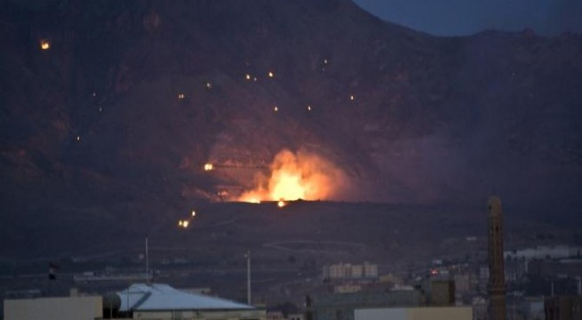 A Saudi-led airstrike hits a site believed to be a weapons cache in Yemen's capital, Sanaa, on Monday, May 11, 2015. The conflict in Yemen has killed over 1,400 people, many of them civilians, since March, according to the United Nations. A humanitarian cease-fire is scheduled on Tuesday, to help ease the suffering of civilians in the country, who have endured shortages of power, water, food and medicine as a result of a Saudi-led naval, air and land blockade in retaliation for Shiite rebels. (AP Photo/Hani Mohammed)