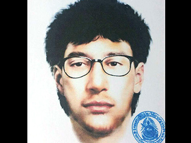 """This image released by the Royal Thai Police on Wednesday, Aug. 19, 2015, shows a detailed sketch of the main suspect in a bombing that killed a number of people at the Erawan shrine in downtown Bangkok, on Monday. Thailand's national police chief said Wednesday that a deadly bombing at a central Bangkok shrine was carried out by """"a network,"""" as investigators focused on a man seen in a grainy security video leaving a backpack behind just 20 minutes before the explosion.  The message above the sketch says """"Criminal record registration department."""" (Royal Thai Police via AP)"""